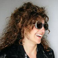 angie-schottmuller-2013-headshot-sunglasses-color-200x200-facing-right